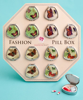 Fan-shaped pill boxes in pretty butterfly designs